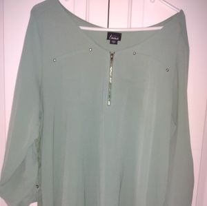 Sage green women's blouse.